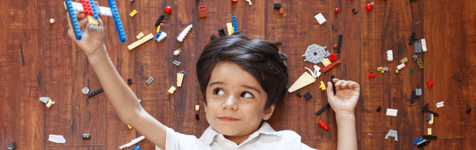 Child in the centre playing with lego.