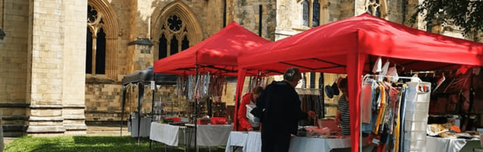 Person visiting stalls in Selby Abbey grounds
