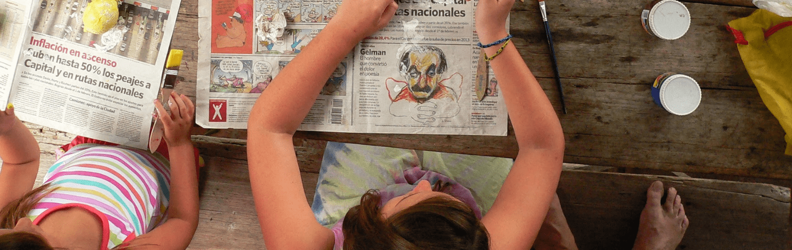 Young girl painting a portrait. Viewed from above.